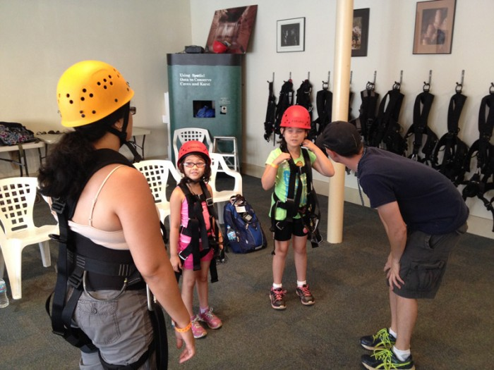 Suiting up for the zipline and repelling.