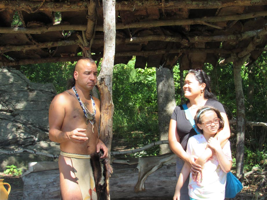 This was an indian from a local tribe. Someone was very interested in his discussion.