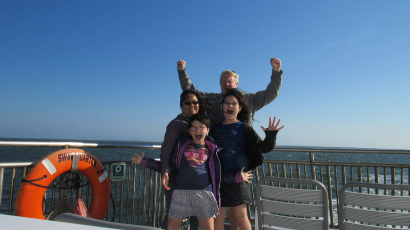 Our family taking the OBX ferry from Ocracoke to Cedar Island.