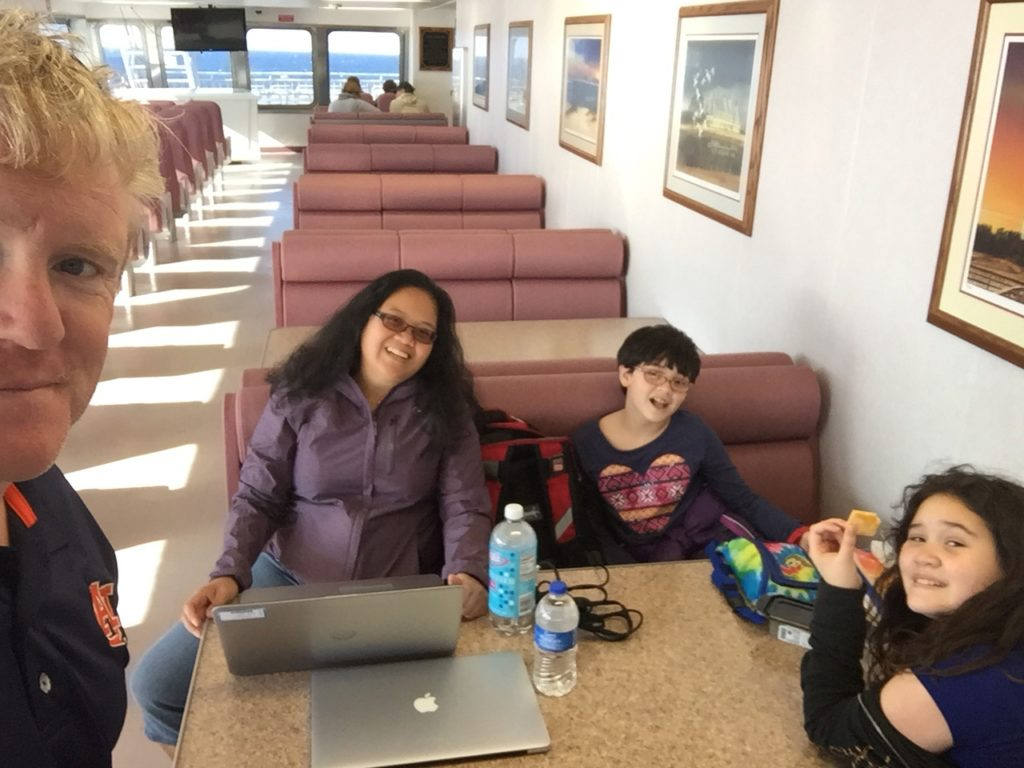 Doing some work on the ferry. We had two hours, we completed some work and school.