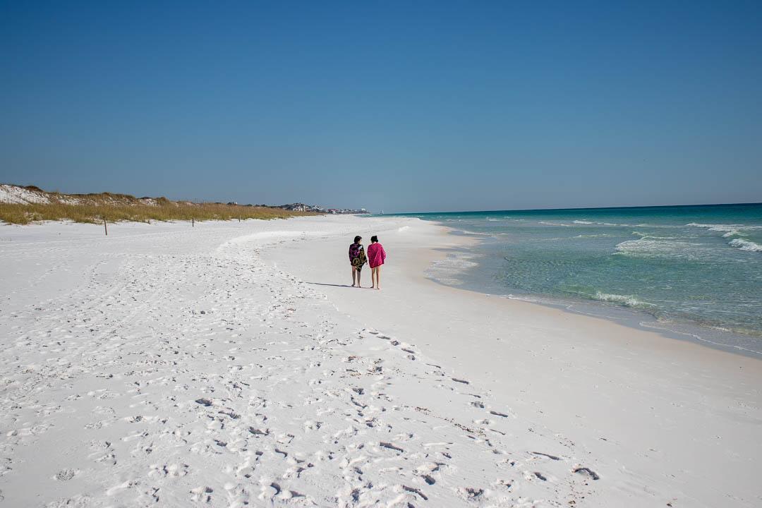 Walking down the Topsail Hill Beach